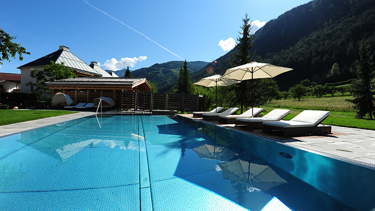 Outdoor pool at Hotel Riederhof
